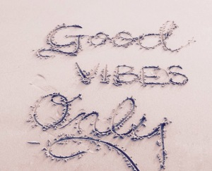 Good vibes only life quote on the beach