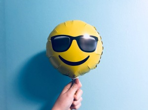 10 ways to have a happy summer - smiley face balloon