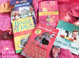 Things to do in the October holidays - reading (pile of books)