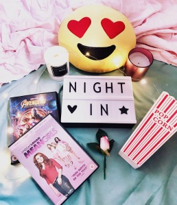 Cosy movie night in with DVDs, candles, popcorn and more