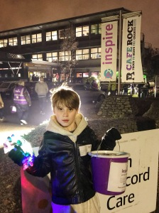 Nathan fundraising for Inspire Aberdeen with his collection bucket