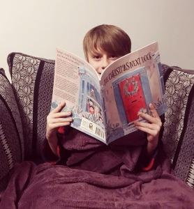 Nathan reading The Christmas next door book