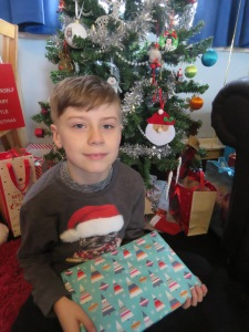 Christmas as a mum - son with a Christmas gift