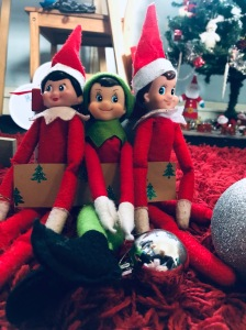 3 Christmas elves sitting together ready to create some family fun