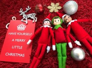 Christmas elves and merry Christmas sign